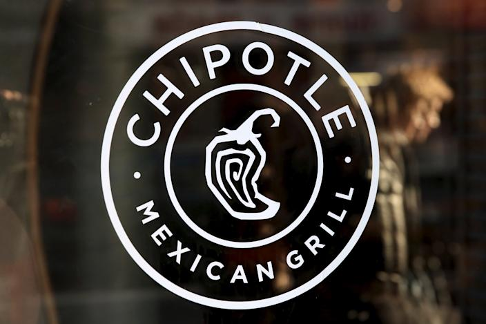 A logo of Chipotle Mexican Grill is seen on a store entrance in Manhattan, New York Nov. 23, 2015.