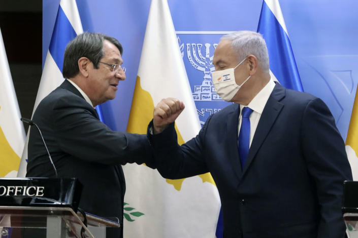 Cyprus President Nicos Anastasiades, left, and Israeli Prime Minister Benjamin Netanyahu bump arms during a press conference after meeting in Jerusalem, Sunday, Feb. 14, 2021. (Marc Israel Sellem/Pool via AP)