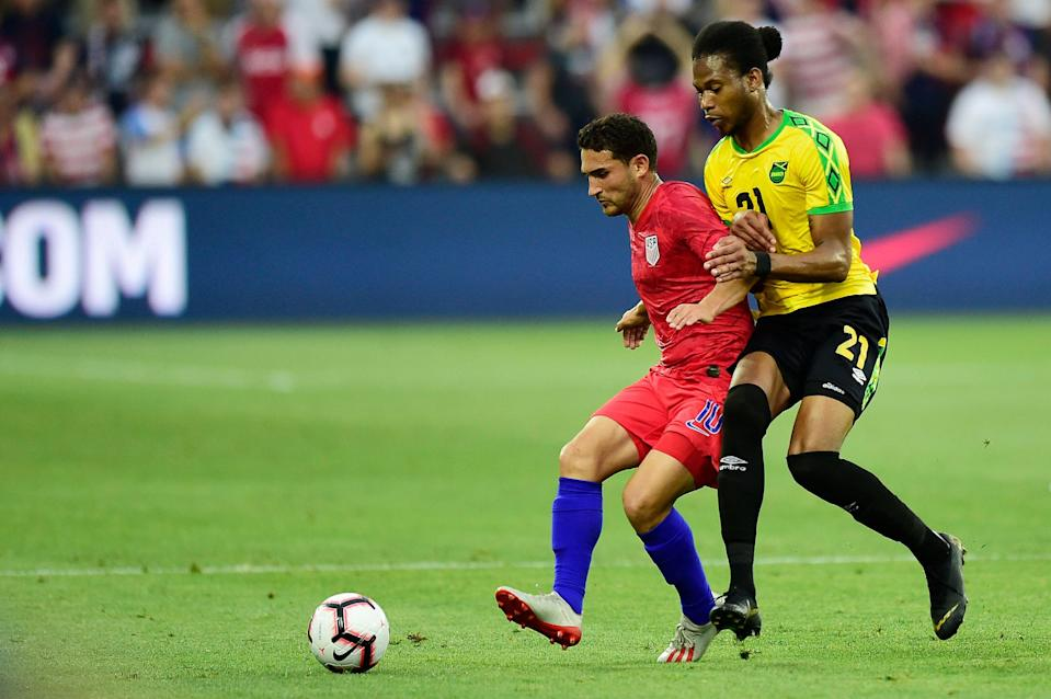 WASHINGTON, DC - JUNE 05: Cristian Roldan #10 of the United States and Kevon Lambert #21 of Jamaica battle for the ball in the first half during an International Friendly at Audi Field on June 5, 2019 in Washington, DC. (Photo by Patrick McDermott/Getty Images)