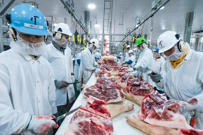 The cutting line in the Triumph Foods pork processing facility in St. Joseph during an April 2017 visit by Agriculture Secretary Sonny Perdue. The facility employs 2,800 workers and more than 600 have tested positive for COVID-19 since April.