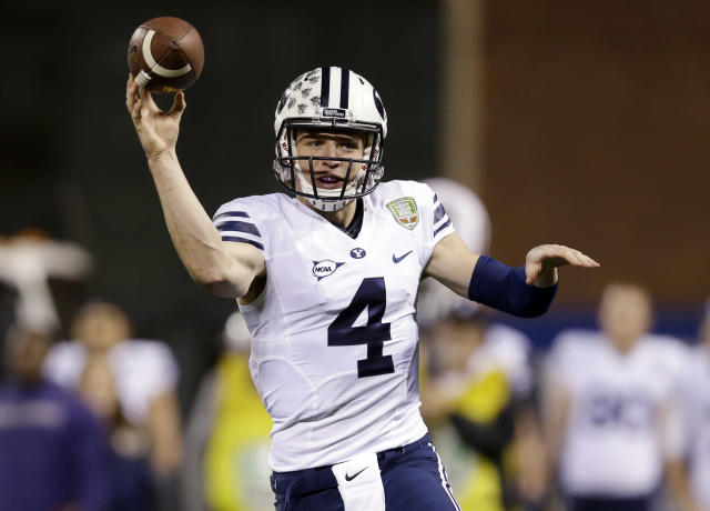 BYU quarterback Taysom Hill throws against Washington during first half of the Fight Hunger Bowl NCAA college football game Friday, Dec. 27, 2013, in San Francisco. (AP Photo/Marcio Jose Sanchez)