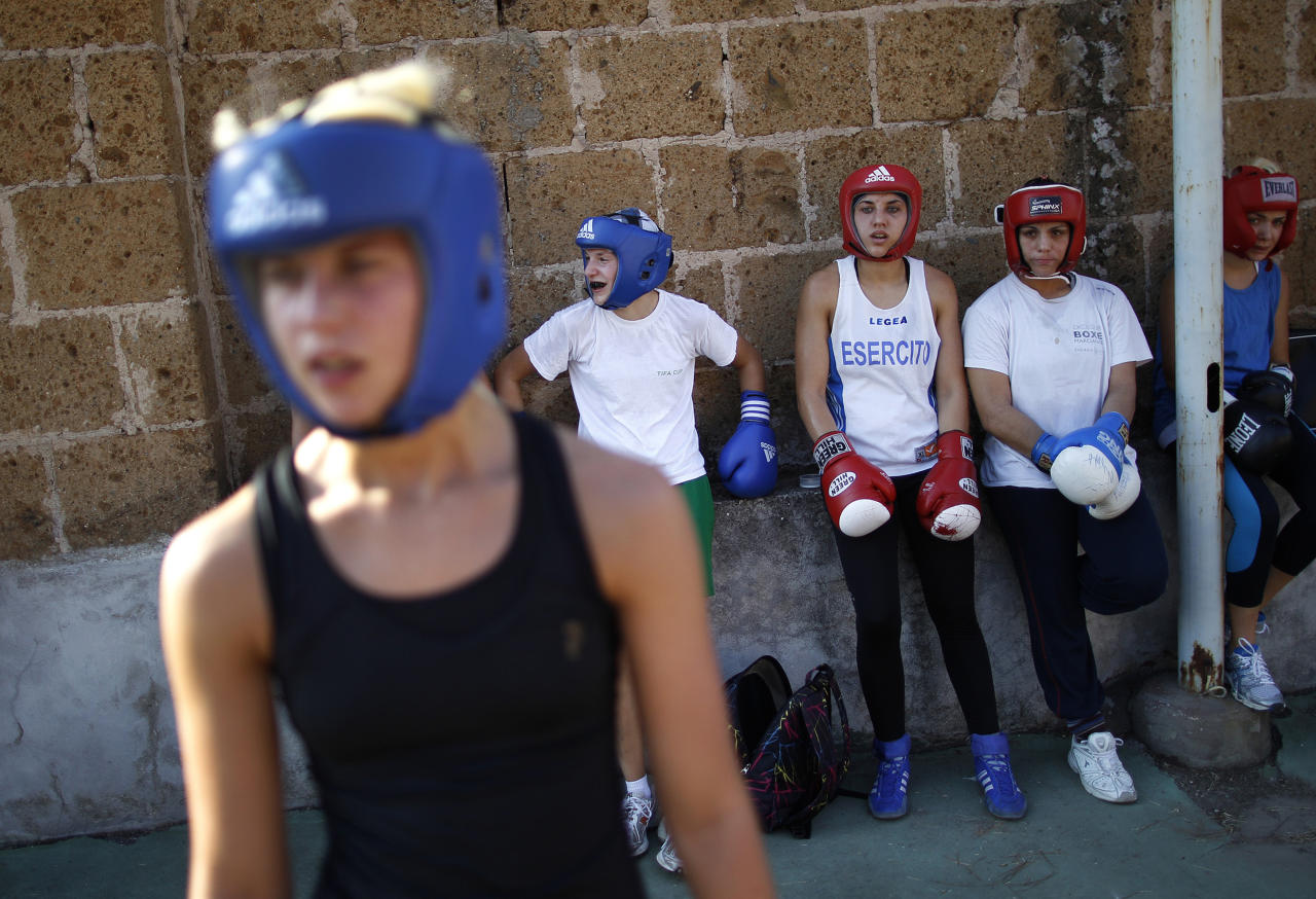 Italian boxer Romina Marenda (C) rests during a training session at the Military Olympic Center in Rome October 6, 2011. Lightweight Marenda will be one of Italy's biggest hopes when women's boxing makes its debut at the London Olympics this year, as long as she manages to qualify at the world championships in China in May. Picture taken October 6, 2011. REUTERS/Tony Gentile