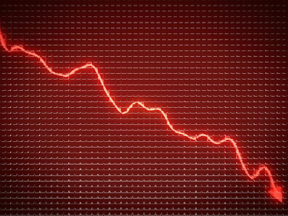 Glowing red arrow on a red stock chart headed down