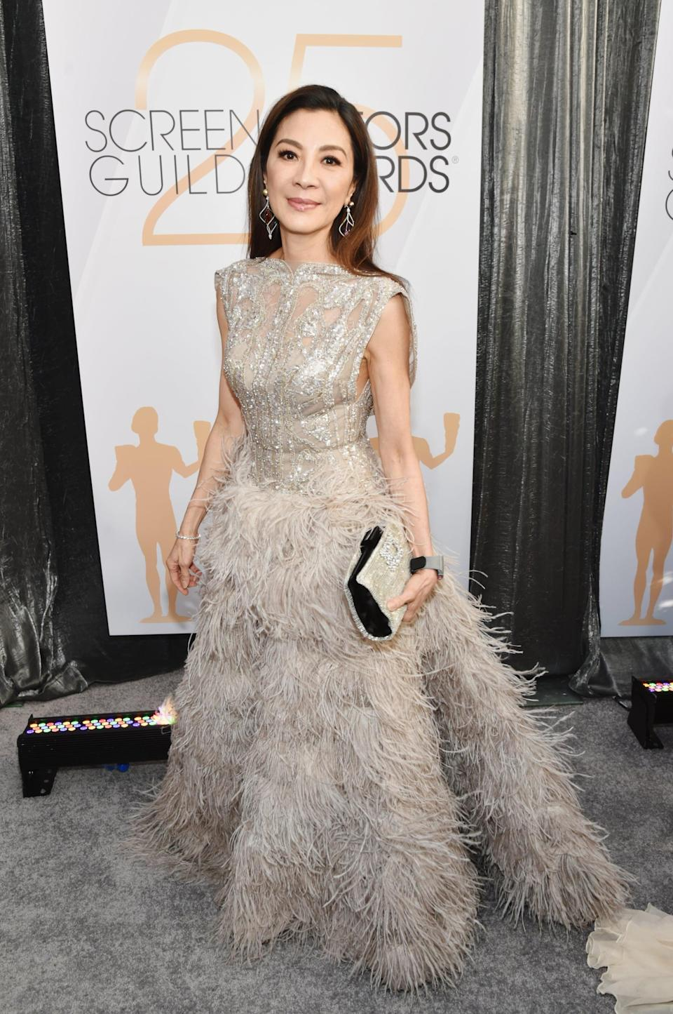 """<p>Wearing an Elie Saab gown with <a rel=""""nofollow noopener"""" href=""""https://www.popsugar.com/fashion/Michelle-Yeoh-Richard-Mille-Watch-2019-SAG-Awards-45718079"""" target=""""_blank"""" data-ylk=""""slk:her own jewels."""" class=""""link rapid-noclick-resp"""">her own jewels.</a> </p>"""