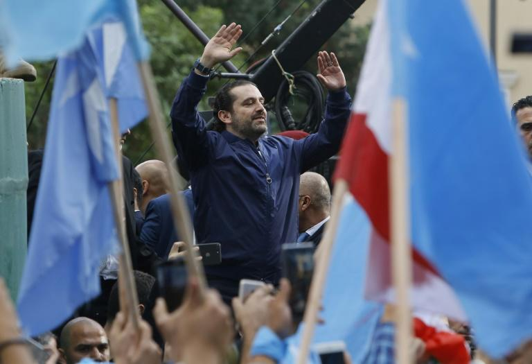 Lebanese Prime Minister Saad Hariri greets supporters outside his Beirut home on November 22, 2017