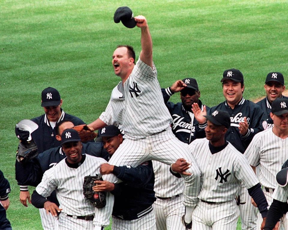 New York Yankees pitcher David Wells is carried off the field by Bernie Williams, left, Willie Banks, second from left, and Darryl Strawberry, right, after pitching a perfect game against the Minnesota Twins on Sunday, May 17, 1998.. (AP Photo/Lou Requena, file)