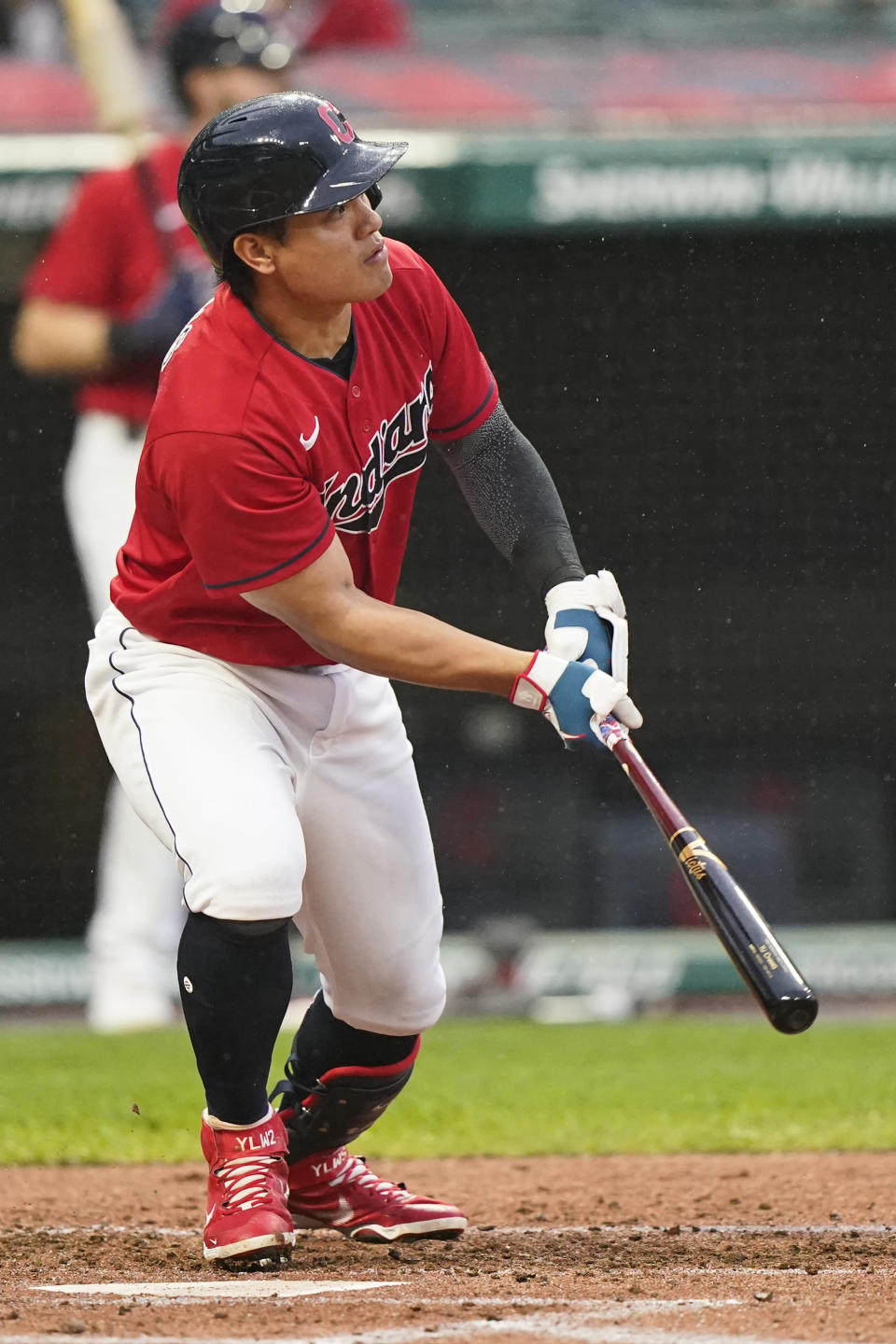 Cleveland Indians' Yu Chang watches his three-run triple in the first inning of a baseball game against the Kansas City Royals, Tuesday, Sept. 21, 2021, in Cleveland. (AP Photo/Tony Dejak)