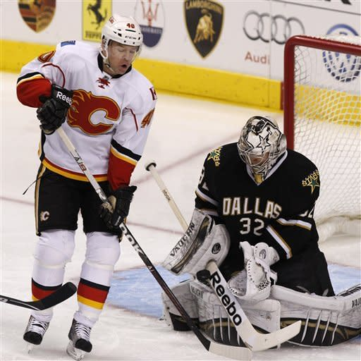 Calgary Flames left wing Alex Tanguay (40) tries to slip the puck past Dallas Stars goalie Kari Lehtonen (32) during the first period of an NHL hockey game in Dallas, Saturday, March 24, 2012. (AP Photo/LM Otero)
