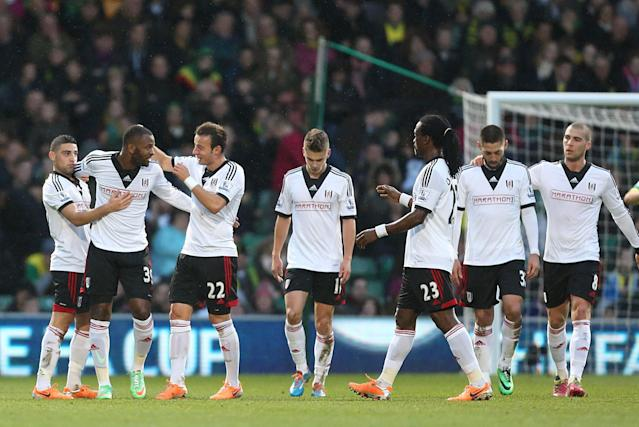 Fulham's Darren Bent, second left, celebrates with teammates after scoring his team's opening goal during their FA Cup third round soccer match against Norwich City at Carrow Road, Norwich, England, Saturday, Jan. 4, 2014. (AP Photo/Chris Radburn, PA Wire)