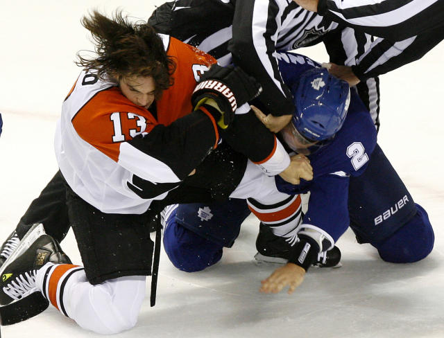 FILE - In this Sept. 17, 2009 file photo, Philadelphia Flyers' Dan Carcillo, left, fights with Toronto Maple Leaf's Luke Schenn during first period pre-season NHL action at the John Labatt Centre in London, Ontario, Canada. Carcillo has been the team's enforcer, but fighting in the NHL is down to its final rounds as the old school enforcer role fades away from game. (AP Photo/The Canadian Press, Dave Chidley)