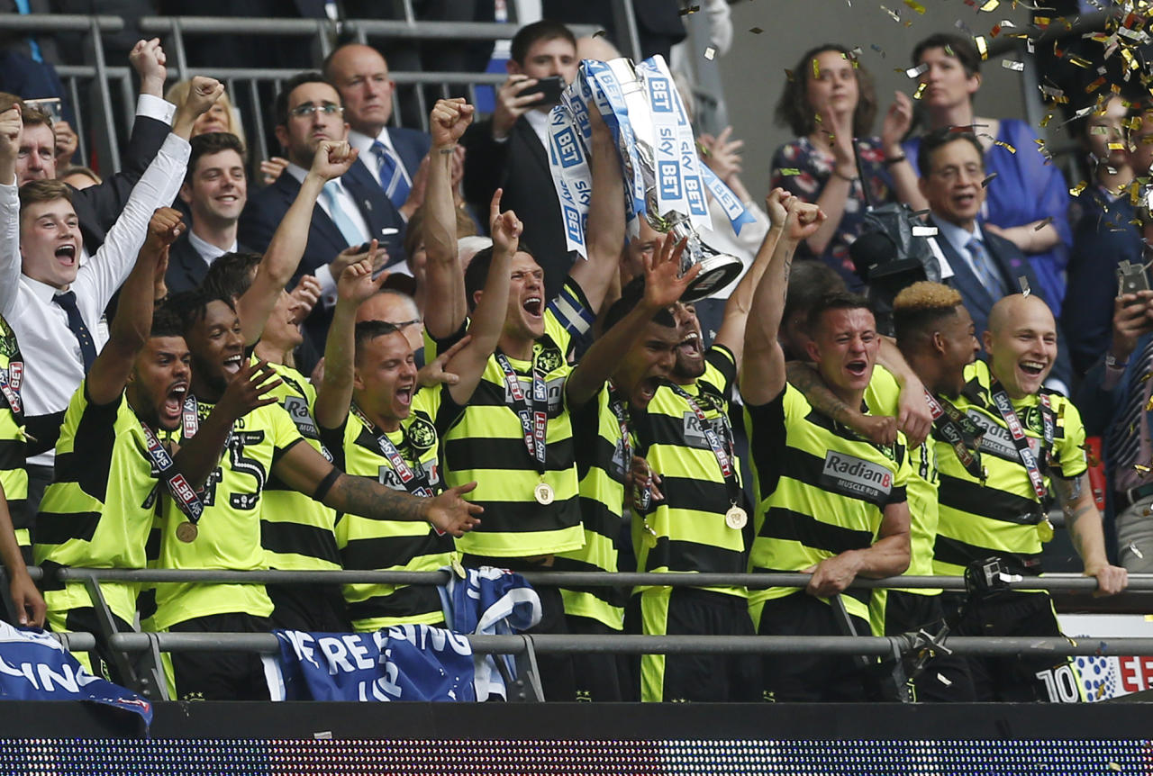 """Britain Football Soccer - Reading v Huddersfield Town - Sky Bet Championship Play-Off Final - Wembley Stadium, London, England - 29/5/17 Huddersfield Town celebrate with the trophy after winning the Sky Bet Championship Play-Off Final and getting promoted to the Premier League  Action Images via Reuters / Matthew Childs Livepic EDITORIAL USE ONLY. No use with unauthorized audio, video, data, fixture lists, club/league logos or """"live"""" services. Online in-match use limited to 45 images, no video emulation. No use in betting, games or single club/league/player publications.  Please contact your account representative for further details."""