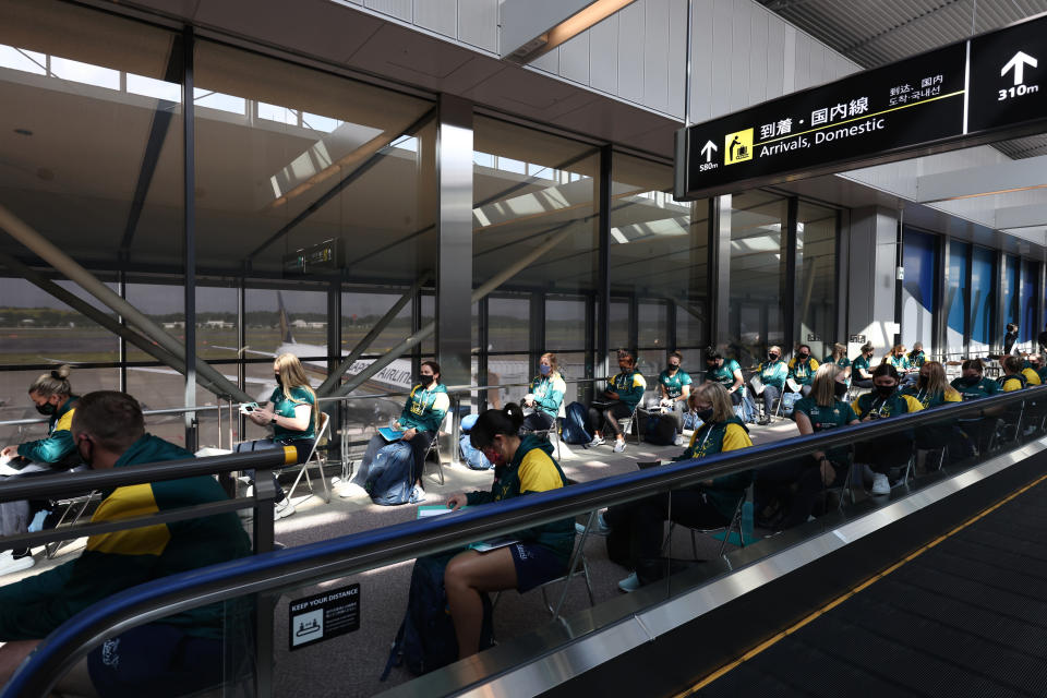 Australian softball national team players wait for the antigen test after arriving at the Narita International Airport in Narita, Chiba prefecture, Tuesday, June 1, 2021. The Australian team is one of the first teams to arrive ahead of the Tokyo 2020 Olympic games, scheduled to open July 23. (Behrouz Mehri/Pool Photo via AP)