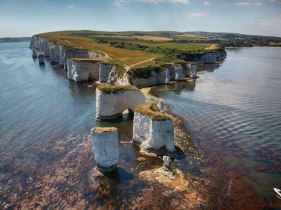 """<p>Winner of the Best Small Village 2019 at Dorset's Best Villages awards, Studland is a popular seaside destination surrounded by a huge nature reserve, and a short walk from the long sandy beaches at Studland Bay. </p><p>As well as irresistible views and the chance to spot some rare wildlife, nearby attractions include the start of the epic South West Coast path, Swanage steam railway and Corfe Castle.</p><p><strong>Where to stay:</strong> <a href=""""https://go.redirectingat.com?id=127X1599956&url=https%3A%2F%2Fwww.booking.com%2Fhotel%2Fgb%2Fknoll-house.en-gb.html%3Faid%3D2070936%26label%3Ddorset-villages&sref=https%3A%2F%2Fwww.prima.co.uk%2Ftravel%2Fg35967807%2Fdorset-villages%2F"""" rel=""""nofollow noopener"""" target=""""_blank"""" data-ylk=""""slk:Knoll House"""" class=""""link rapid-noclick-resp"""">Knoll House</a> is a great option for a <a href=""""https://www.prima.co.uk/travel/g34811077/family-beach-holidays-uk/"""" rel=""""nofollow noopener"""" target=""""_blank"""" data-ylk=""""slk:family-friendly stay"""" class=""""link rapid-noclick-resp"""">family-friendly stay</a> overlooking the beach, with a kids' play area, spacious lawns and an outdoor and indoor pool.</p><p><a class=""""link rapid-noclick-resp"""" href=""""https://go.redirectingat.com?id=127X1599956&url=https%3A%2F%2Fwww.booking.com%2Fhotel%2Fgb%2Fknoll-house.en-gb.html%3Faid%3D2070936%26label%3Ddorset-villages&sref=https%3A%2F%2Fwww.prima.co.uk%2Ftravel%2Fg35967807%2Fdorset-villages%2F"""" rel=""""nofollow noopener"""" target=""""_blank"""" data-ylk=""""slk:CHECK AVAILABILITY"""">CHECK AVAILABILITY</a></p>"""