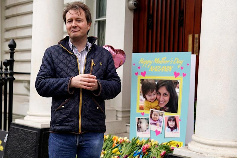 Richard Ratcliffe, the husband of the jailed UK-Iranian woman Nazanin Zaghari-Ratcliffe, delivers a mothers day card and flowers to the Iranian Embassy (EPA)