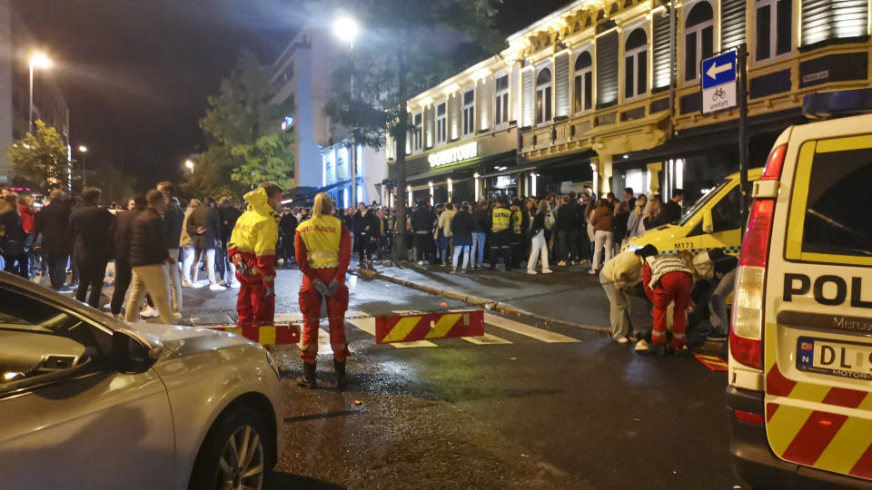 An ambulance takes care of the injured as Norway reopens from the coronavirus restrictions in Trondheim, Norway, Saturday, Sept. 25, 2021. The government is easing the national regulations introduced in connection with the coronavirus pandemic. (Joakim Halvorsen/NTB via AP)