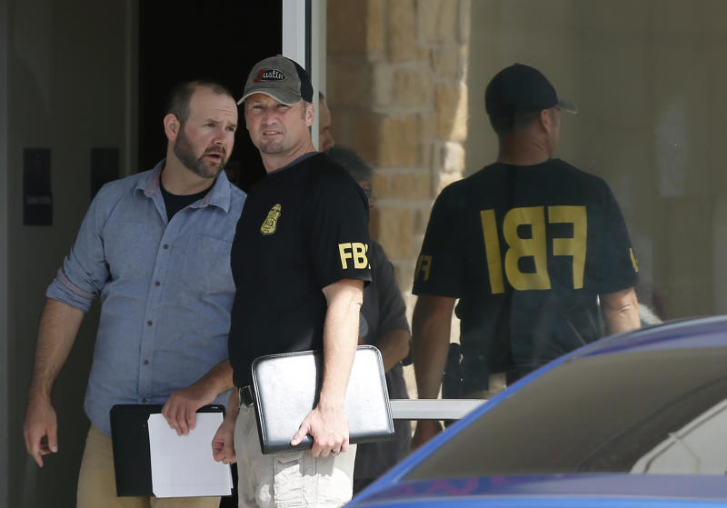 Law enforcement officials investigate Saturday's shooting at a shopping center Sunday, Sept. 1, 2019, in Odessa, Texas. (AP Photo/Sue Ogrocki)