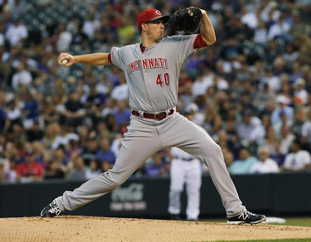 Cincinnati Reds starting pitcher Greg Reynolds works against the Colorado Rockies in the first inning of a baseball game in Denver on Saturday, Aug. 31, 2013. (AP Photo/David Zalubowski)