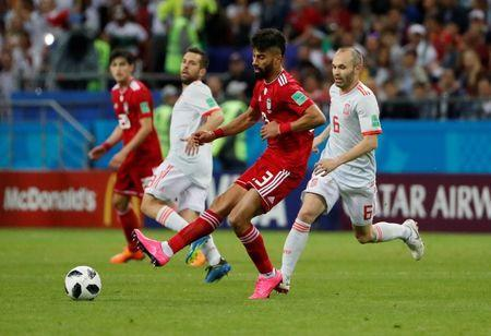 Soccer Football - World Cup - Group B - Iran vs Spain - Kazan Arena, Kazan, Russia - June 20, 2018 Iran's Ramin Rezaeian in action with Spain's Andres Iniesta REUTERS/Jorge Silva