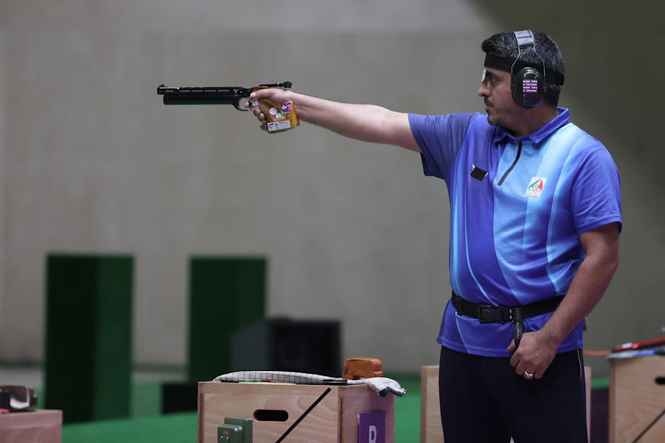 Javad Foroughi competes during finals of the 10m Air Pistol Men's event on Saturday. (Kevin C. Cox/Getty Images)