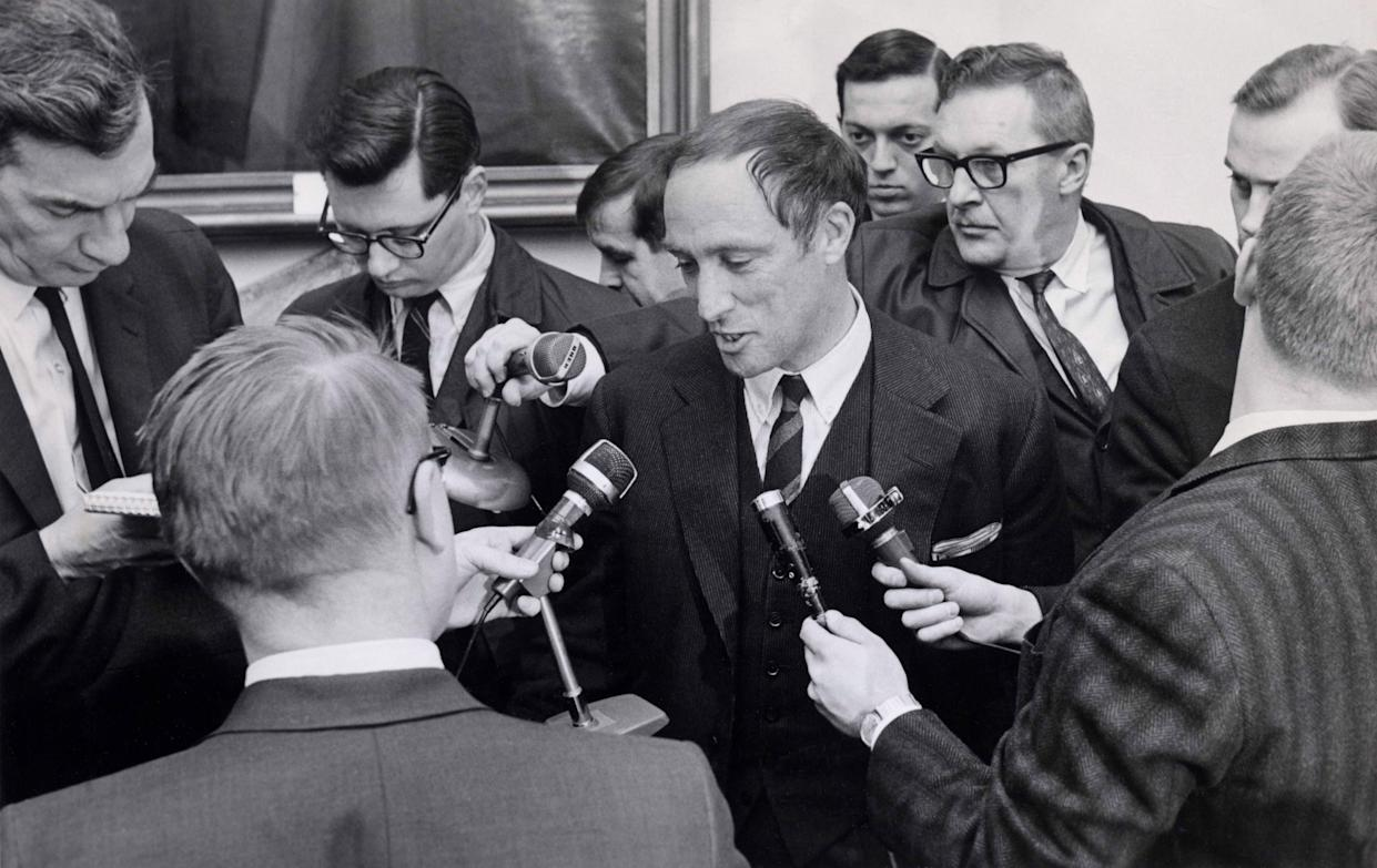 Reporters swarm around Justice Minister Pierre Elliot Trudeau after he was sworn-in in Ottawa, Ontario on Tuesday, April 4, 1967. Mr. Trudeau has been Prime Minister Pearson's parliamentary secretary since January 1966. THE CANADIAN PRESS/Chuck Mitchell