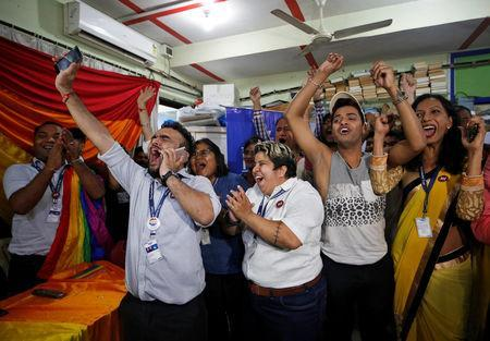 <p>People belonging to the lesbian, gay, bisexual and transgender (LGBT) community celebrate after the Supreme Court's verdict of decriminalizing gay sex and revocation of the Section 377 law, at an NGO in Mumbai, India, September 6, 2018. REUTERS/Francis Mascarenhas </p>