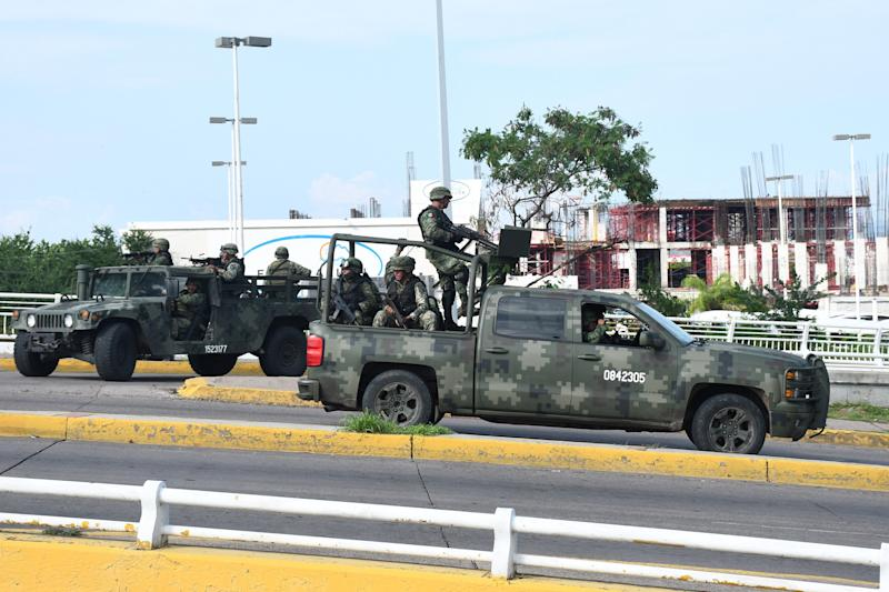 """A handout photo made available by El Debate de Sinaloa shows clashes between armed groups and federal forces, in Culiacan, Mexico, 17 October 2019 during an attempt to capture a son of convicted drug lord Joaquin """"El Chapo"""" Guzman."""