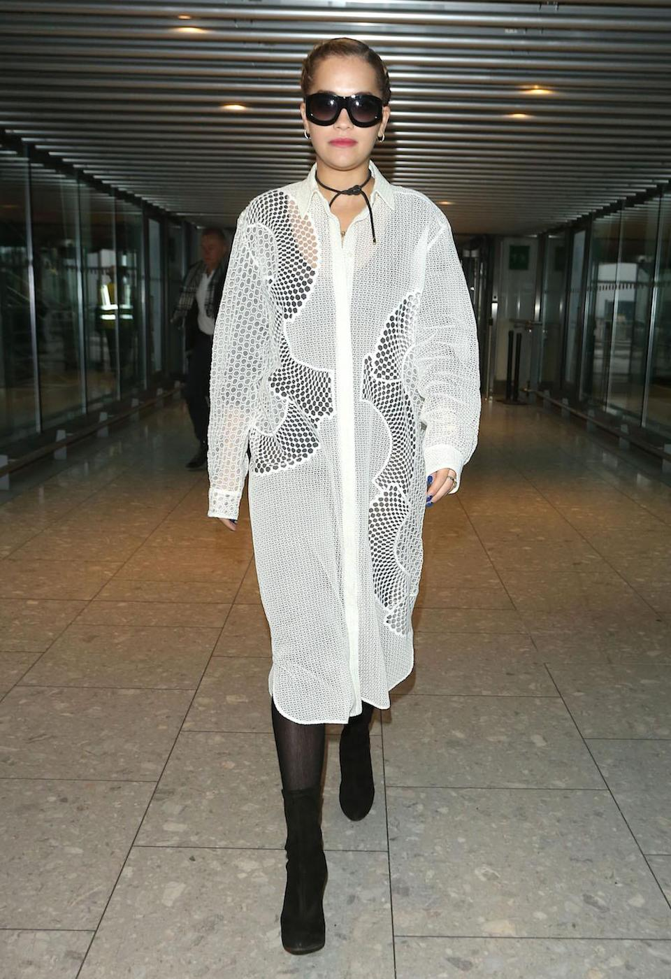 <p>A black bodysuit and tights allow all the details of Rita's oversized shirt dress to shine through. <i>(Splash News)</i></p>