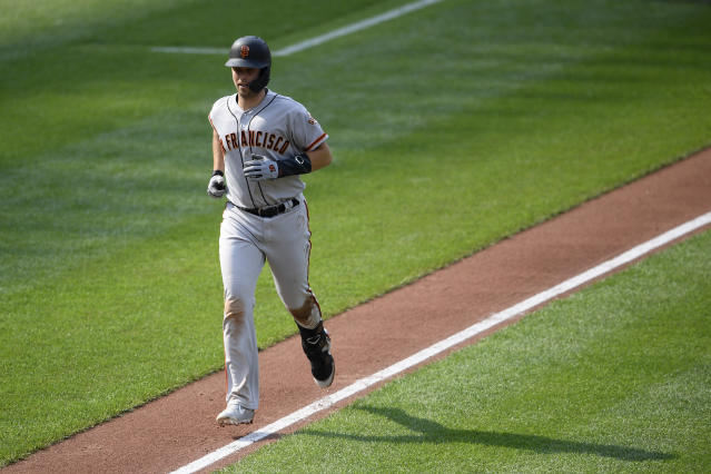 San Francisco Giants' Buster Posey trots home after hitting a home run during the third inning of a baseball game against the Baltimore Orioles, Saturday, June 1, 2019, in Baltimore. (AP Photo/Nick Wass)