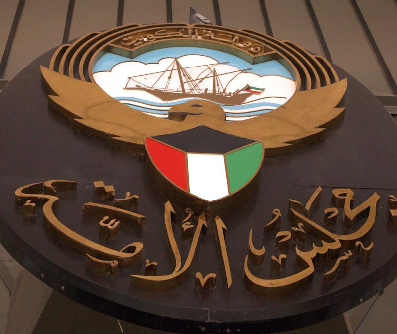 The shield of the Kuwait's National Assembly hangs at the entrance of the building in Kuwait City on June 18, 2012