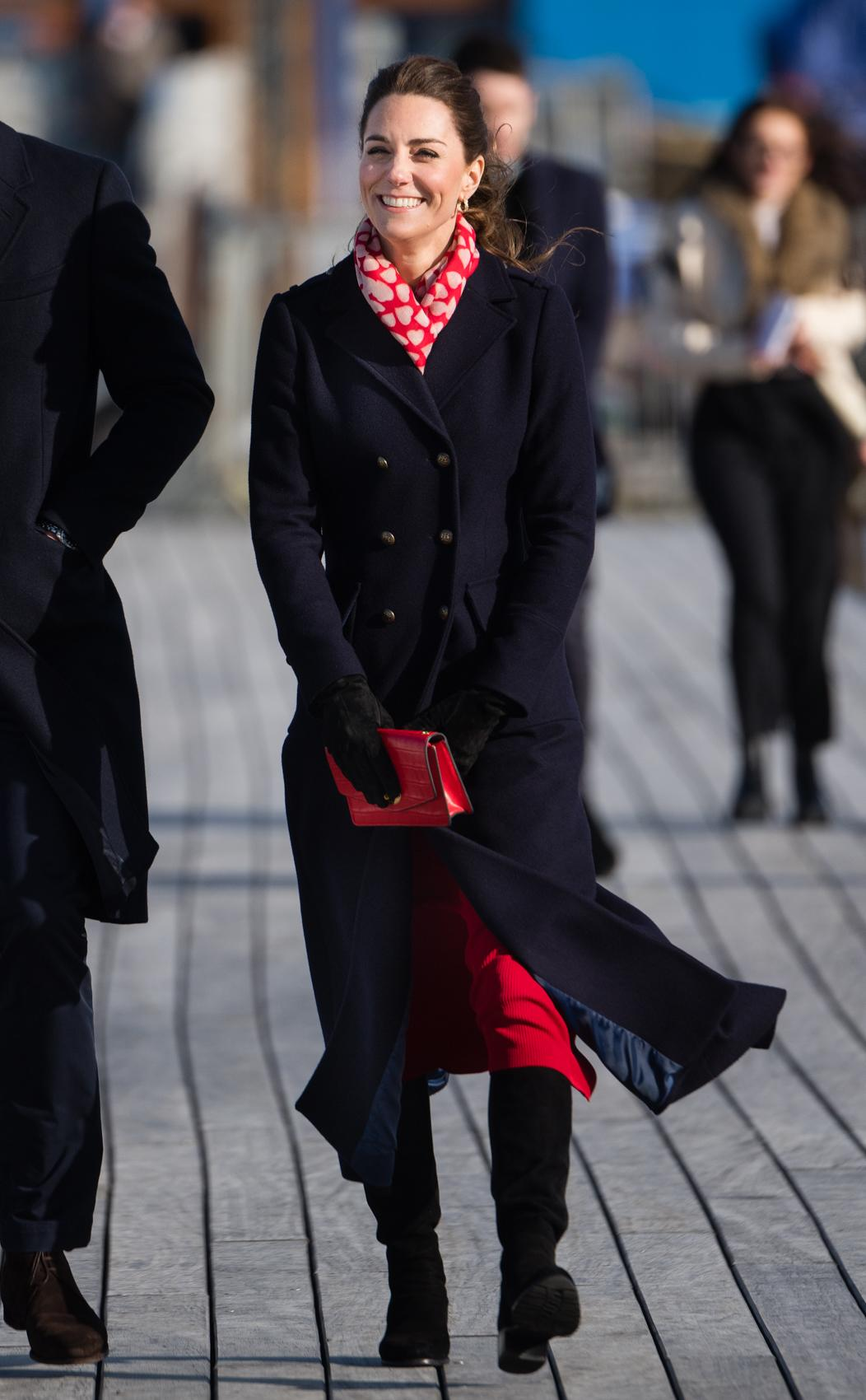 The Duchess of Cambridge paired the coat with a red Zara coat and heart-adorned scarf. [Photo: Getty]