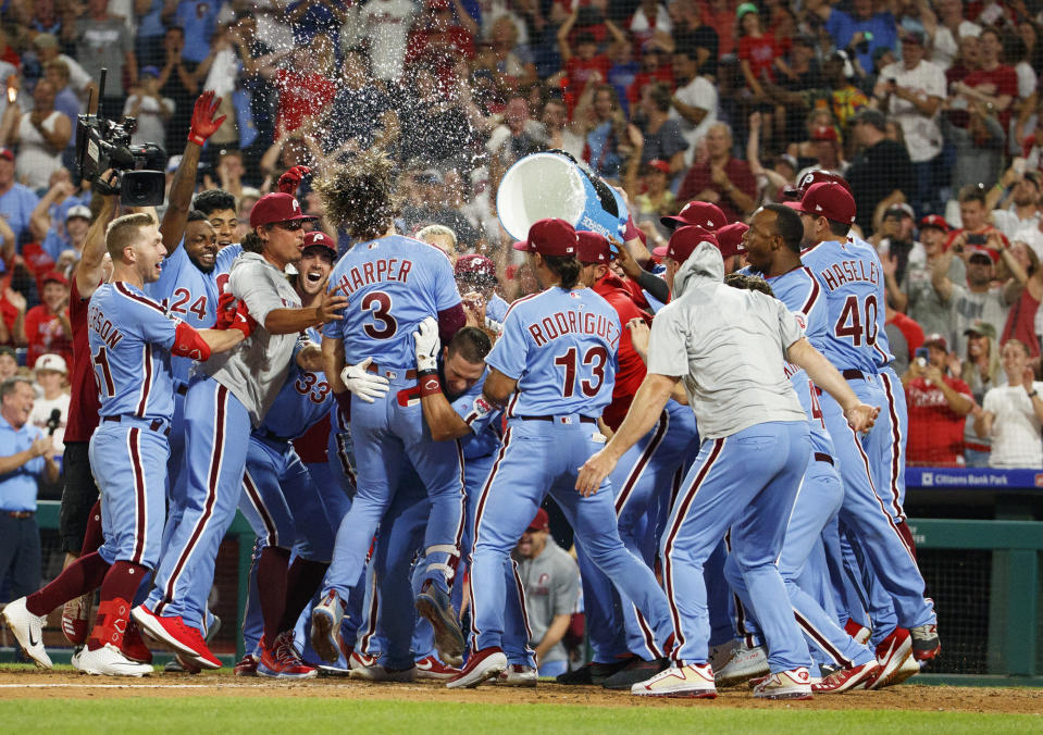 Bryce Harper sinks Cubs with dramatic walk-off grand slam. (AP Photo/Chris Szagola)