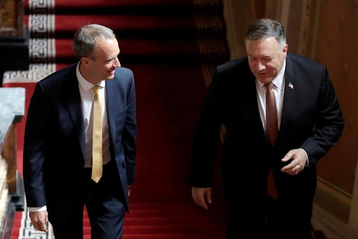 Foreign Secretary Dominic Raab of Britain and  Secretary of State Mike Pompeo (right) walk up the stairs in the Foreign Office in London on July 21, 2020. Pompeo met with Raab   just hours after Britain suspended its extradition treaty with Hong Kong and blocked arms sales to the former British territory.