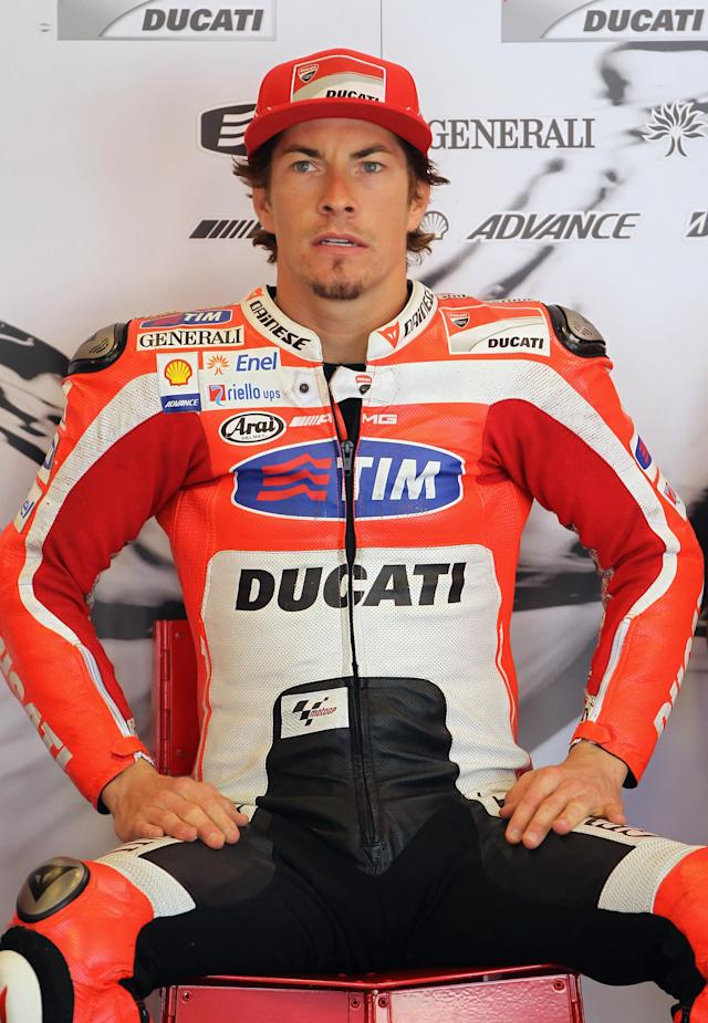 INDIANAPOLIS, IN - AUGUST 27: Nicky Hayden #69 of the USA looks out from the pit garage during Moto GP qualifying at Indianapolis Motorspeedway on August 27, 2011 in Indianapolis, Indiana. (Photo by Jamie Squire/Getty Images)