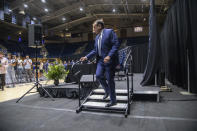 Duke University basketball coach Mike Krzyzewski walks off stage following an NCAA college basketball news conference Thursday, June 3, 2021, at Cameron Indoor Stadium in Durham, N.C. Krzyzewski, the winningest coach in the history of Division I men's college basketball announced that next season will be his last with the Blue Devils program he has built into one of college basketball's bluebloods. The school named former Duke player and associate head coach Jon Scheyer as his successor for the 2022-23 season. (Travis Long/The News & Observer via AP)