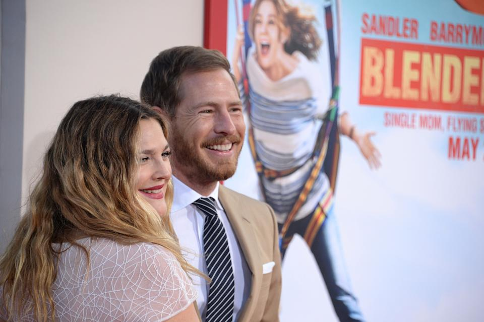 """Drew Barrymore and Will Kopelman arrive for the red carpet premiere of """"Blended,"""" May 21, 2014 at TCL Chinese Theatre in Hollywood, California. (AFP PHOTO / ROBYN BECK via Getty Images)"""
