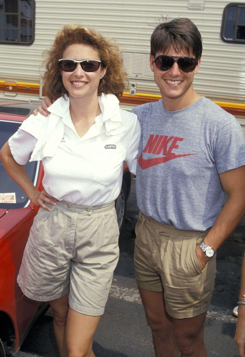 <p>This is impressive. Cruise (with his then wife, Mimi Rogers) makes pleated shorts look stylish. Also, cool Nike shirt. </p>