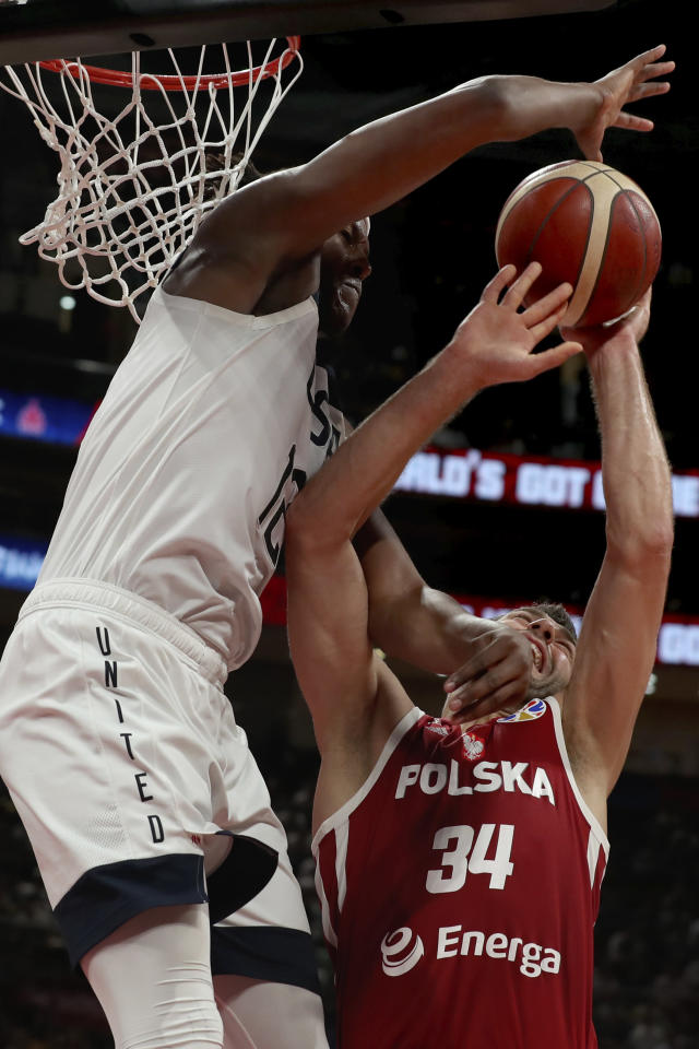 United States' Myles Turner blocks Poland's Adam Hrycaniuk during a consolation playoff game for the FIBA Basketball World Cup at the Cadillac Arena in Beijing on Saturday, Sept. 14, 2019. U.S. defeated Poland 87-74 (AP Photo/Ng Han Guan)