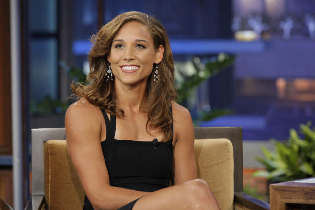 THE TONIGHT SHOW WITH JAY LENO -- Episode 4277 -- Pictured: Olympian Lolo Jones during an interview on June 25, 2012 -- (Photo by: Stacie McChesney/NBC/NBCU Photo Bank via Getty Images)