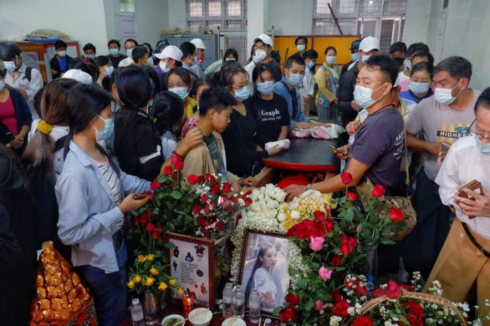 People attend the funeral of Angel, 19-year-old protester also known as Kyal Sin who was shot in the head as Mynamar forces opened fire to disperse an an anti-coup demonstration in Mandalay