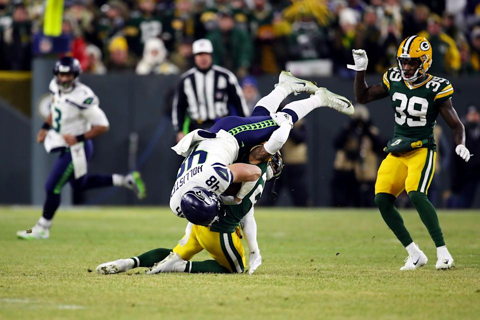 After admitting they got it wrong, NFL officials still allowed a bad call to stand and further punished the Packers by docking them a challenge. (Gregory Shamus/Getty Images)