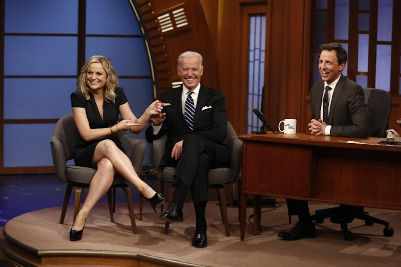"In this photo provided by NBC, from left, actress Amy Poehler and Vice President Joe Biden appear with host Seth Meyers on the premiere of ""Late Night with Seth Meyers"" on Monday, Feb. 24, 2014, in New York. (AP Photo/NBC, Peter Kramer)"
