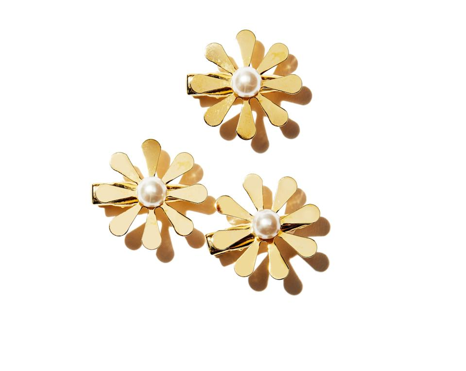 """<p>Spring shouldn't be your only excuse to wear florals, especially in your hair. Pair Lelet NY's chic Comin Up Daises hair clips with your winter wardrobe. The 14-karat, gold-plated clips with glass pearl centers can be worn solo, but look best together. They're perfect for adding some dimension to your slicked-back ponytail or chunky braid.</p> <p><strong>$118</strong> <strong>for three clips</strong> (<a href=""""https://leletny.com/products/comin-up-daisies-clip-set-of-3?_pos=1&_sid=fd329eea0&_ss=r"""" rel=""""nofollow noopener"""" target=""""_blank"""" data-ylk=""""slk:Shop Now"""" class=""""link rapid-noclick-resp"""">Shop Now</a>)</p>"""