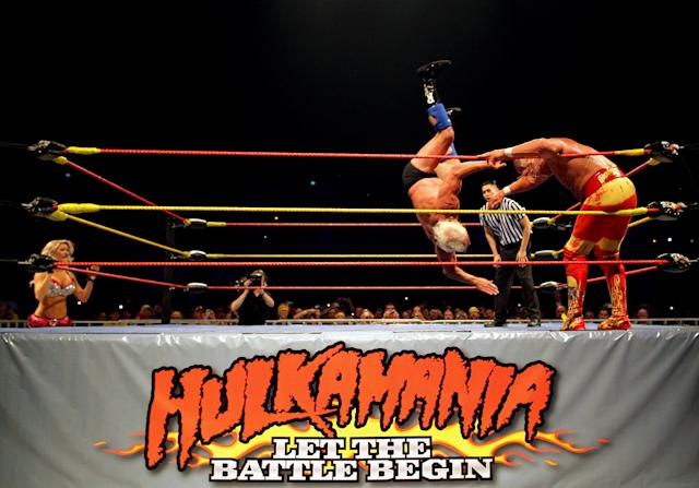 <p>Hulk Hogan throws his opponent Ric Flair to the floor during Hulk Hogan's Hulkamania Tour at Rod Laver Arena on November 21, 2009 in Melbourne, Australia. (Photo by Mark Dadswell/Getty Images) </p>