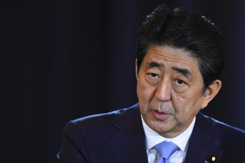 Japan's Prime Minister Shinzo Abe, who will be in Hawaii on December 26 and 27, will visit the site of the surprise Japanese attack on December 7, 1941, that began World War II in the Pacific (AFP Photo/EITAN ABRAMOVICH)
