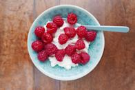 """<p>All fruit is a great choice since the sugar is naturally occurring versus added, but <a href=""""https://www.goodhousekeeping.com/health/diet-nutrition/a20916472/blueberries-nutrition/"""" rel=""""nofollow noopener"""" target=""""_blank"""" data-ylk=""""slk:berries particularly"""" class=""""link rapid-noclick-resp"""">berries particularly</a> are both low in sugar and super high in dietary fiber, which can help you feel fuller, longer. Mix a cup with a 1/2 cup of cottage cheese for a sweet and slightly tart midday treat.</p>"""