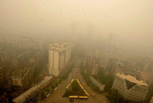 A thick yellow cloud covers a busy intersection in Wuhan on June 11. Wuhan was blanketed by thick yellowish cloud Monday, raising fears of pollution among its nine million inhabitants, residents told AFP. Witnesses said the haze appeared suddenly in the morning, and residents rushed to put on face masks