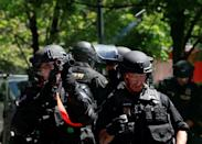 <p>Police fire projectiles at counterprotesters during a rally by the Patriot Prayer group in Portland, Ore., Aug. 4, 2018. (Photo: Bob Strong/Reuters) </p>