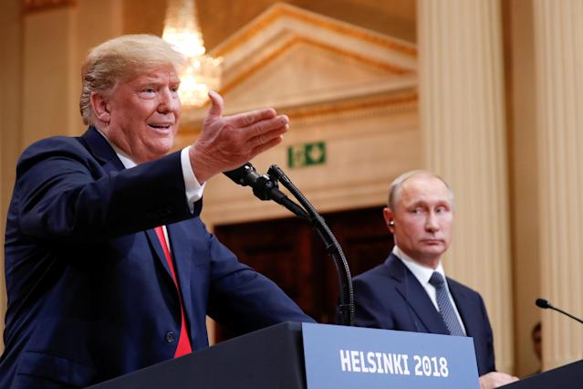 President Trump speaks during the joint press conference with Russian President Vladimir Putin in Helsinki on Monday. (Photo: Kevin Lamarque/Reuters)
