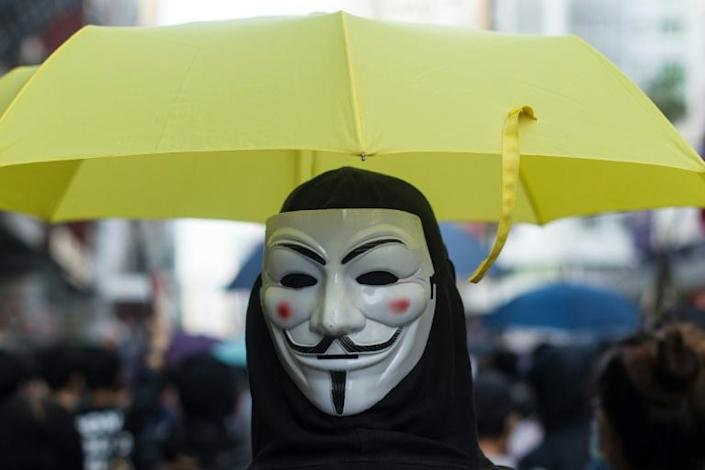 A protester in a Guy Fawkes mask takes part in a pro-democracy march in Hong Kong (AFP Photo/Philip FONG)