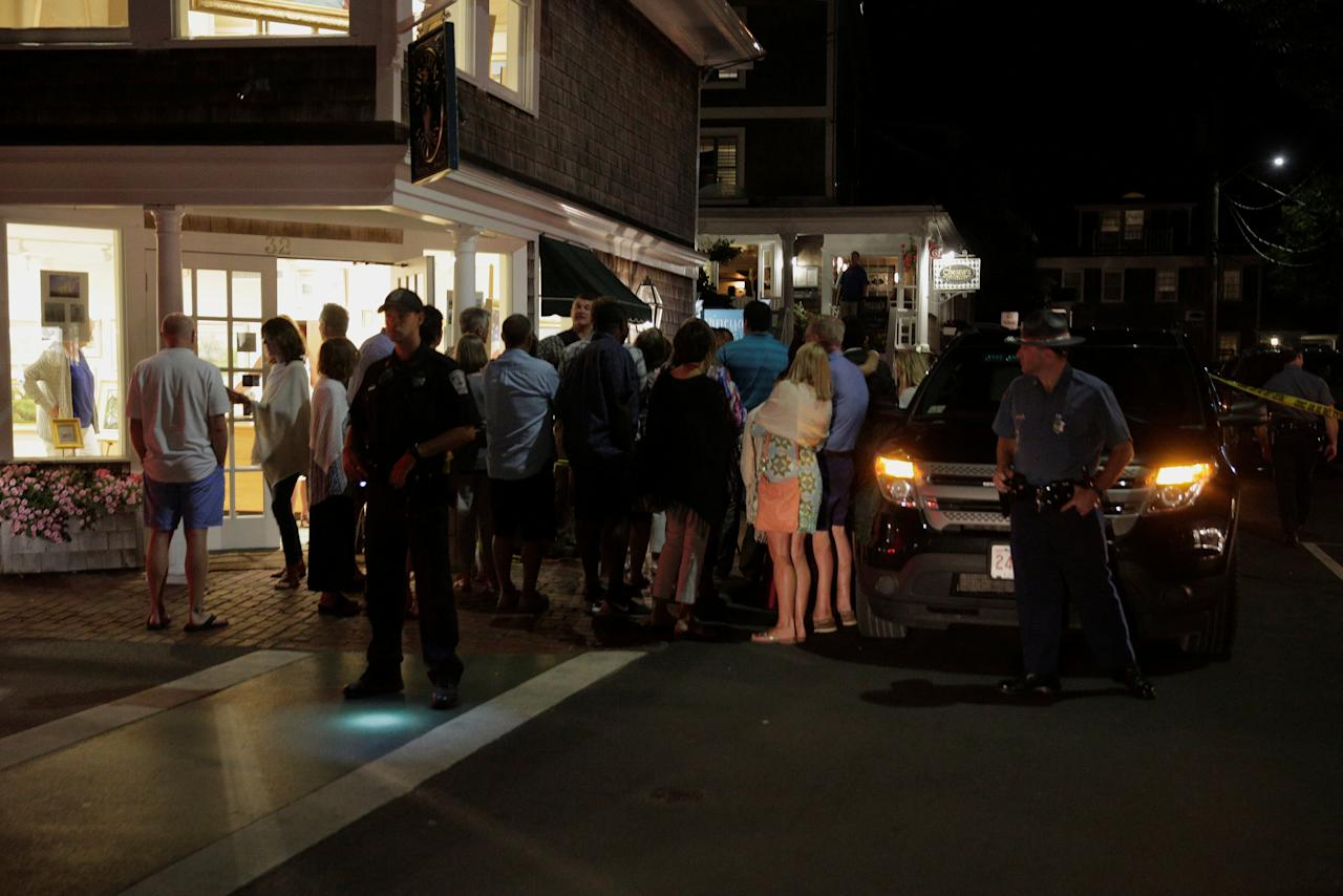 People look at U.S. President Barack Obama and U.S. first lady Michelle Obama as they have dinner in Edgartown, Massachusetts, U.S., August 20, 2016. REUTERS/Joshua Roberts